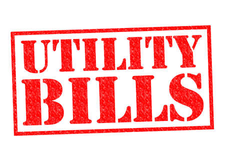 UTILITY BILLS red Rubber Stamp over a white background. photo