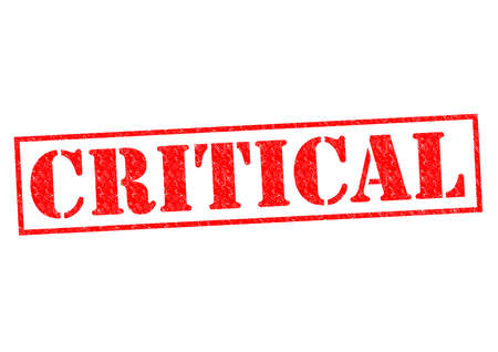 critical conditions: CRITICAL red Rubber Stamp over a white background.