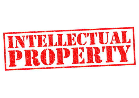 intellectual property: INTELLECTUAL PROPERTY red Rubber Stamp over a white background.