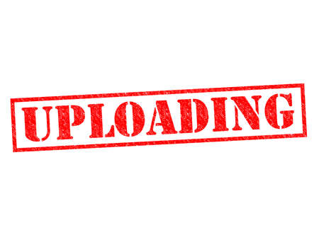 UPLOADING red Rubber Stamp over a white background. photo