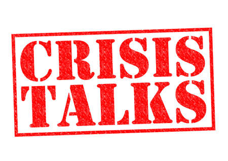 talks: CRISIS TALKS red Rubber Stamp over a white background. Stock Photo