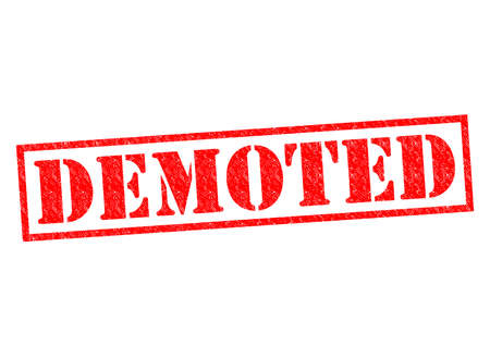 DEMOTED red Rubber Stamp over a white background. Stock Photo