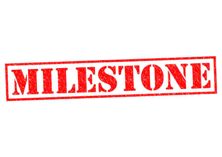 MILESTONE red Rubber Stamp over a white background. photo