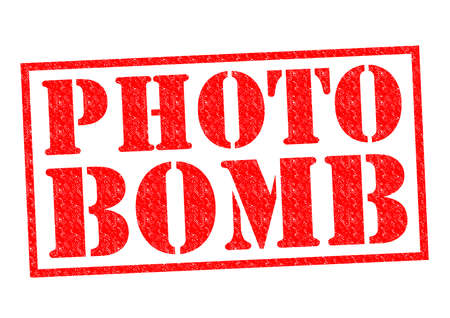intrude: PHOTO BOMB red Rubber Stamp over a white background.