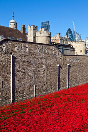 A view showing the ceramic Poppies of the Blood Swept Lands and Seas of Red installation at the Tower of London.  The installation was created by artist Paul Cummins to mark the centenary of the outbreak of the First World War.