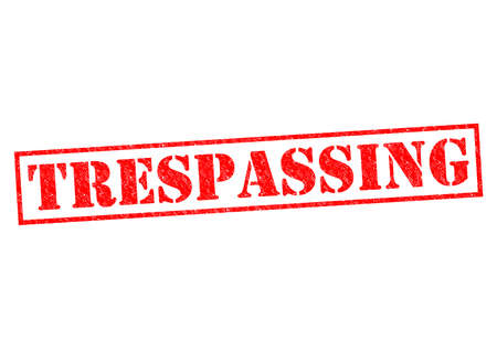 TRESPASSING red Rubber Stamp over a white background.