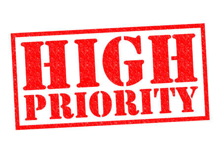 HIGH PRIORITY red Rubber Stamp over a white background. Stock Photo