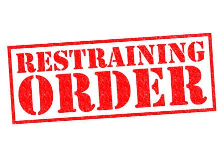 restraining: RESTRAINING ORDER red Rubber Stamp over a white background.