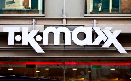 homeware: LONDON, UK - NOVEMBER 29TH 2014: The sign for the T.K. MAXX retail store near Covent Garden in London, on 29th November 2014.  Founded in 1976, it sells clothing, as well as toys, bath and beauty accessories and other homeware. Editorial