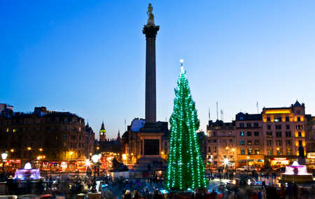 A beautiful shot of Trafalgar Square in London at Christmas.  The view takes in the sights of the Christmas Tree, Nelsons Column, the Traflgar Square fountains and the Houses of Parliament in the distance.