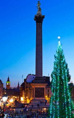 A beautiful shot of Trafalgar Square in London at Christmas.  The view takes in the sights of the Christmas Tree, Nelsons Column, and the Houses of Parliament in the distance.