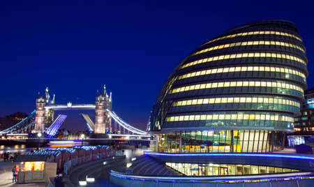A view at dusk of Tower Bridge and City Hall in London. photo