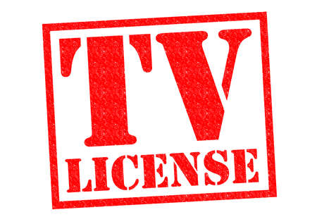 authorisation: TV LICENSE red Rubber Stamp over a white background. Stock Photo