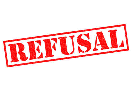 banning the symbol: REFUSAL red Rubber Stamp over a white background.