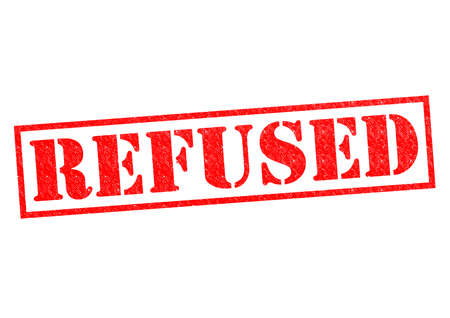 refused: REFUSED red Rubber Stamp over a white background.