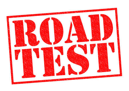 examiner: ROAD TEST red Rubber Stamp over a white background. Stock Photo