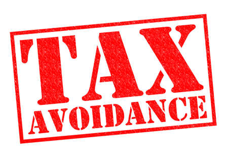tax evasion: TAX AVOIDANCE red Rubber Stamp over a white background.