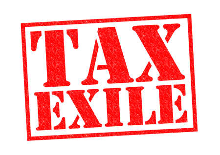 exile: TAX EXILE red Rubber Stamp over a white background. Stock Photo