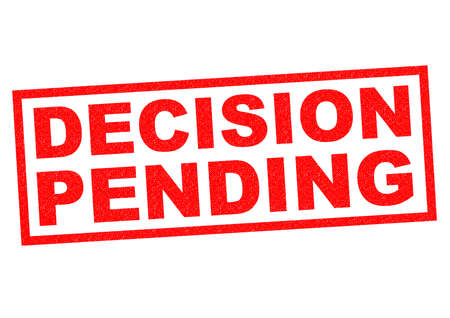 forthcoming: DECISION PENDING red Rubber Stamp over a white background. Stock Photo