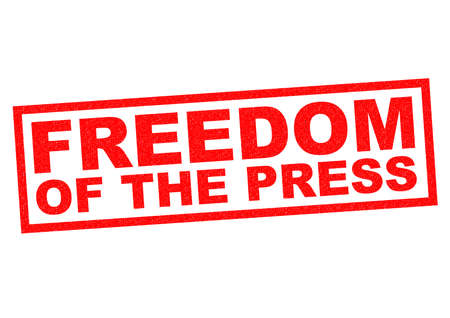 FREEDOM OF THE PRESS red Rubber Stamp over a white background. photo