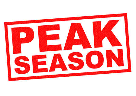optimum: PEAK SEASON red Rubber Stamp over a white background.