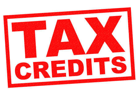 TAX CREDITS red Rubber Stamp over a white background. Stock Photo