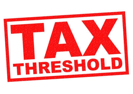 threshold: TAX THRESHOLD red Rubber Stamp over a white background.