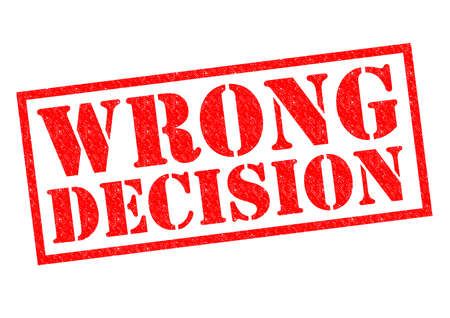 ruling: WRONG DECISION red Rubber Stamp over a white background.