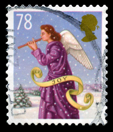 used stamp: UNITED KINGDOM - CIRCA 2007: A used British postage stamp depicting a Christmas message, circa 2007. Editorial