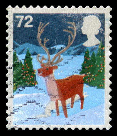 christmassy: UNITED KINGDOM - CIRCA 2006: A used British Postage Stamp depicting a Christmassy scene, circa 2006.