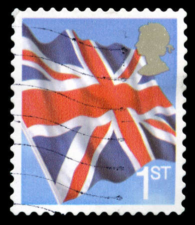postmarked: UNITED KINGDOM - CIRCA 2001: A used British postage stamp depicting an image of the Union Flag, circa 2001. Editorial