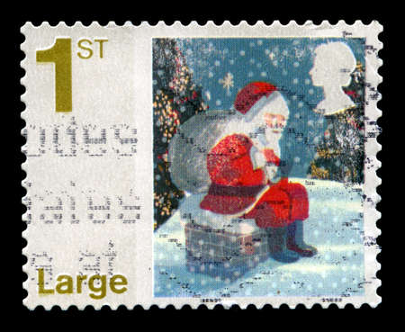 saint nick: UNITED KINGDOM - CIRCA 2006: A used British Postage Stamp depicting a scene of Santa Claus sitting on a Chimney, circa 2006. Editorial