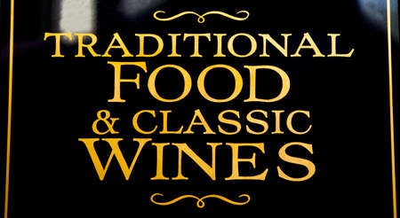 alehouse: A pub sign advertising Traditional Food and Classic Wines. Stock Photo