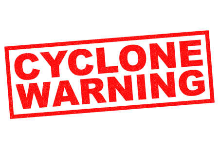 warned: CYCLONE WARNING red Rubber Stamp over a white background.