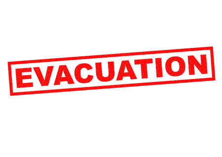 evacuation: Goma roja EVACUACI�N sello sobre un fondo blanco. Foto de archivo
