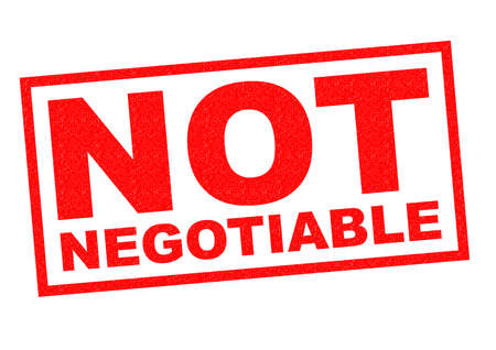 transferable: NOT NEGOTIABLE red Rubber Stamp over a white background.