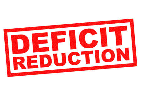 credit crunch: DEFICIT REDUCTION red Rubber Stamp over a white background.
