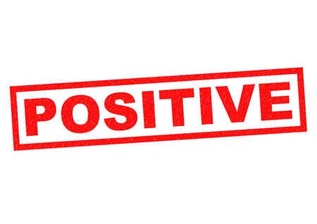 favourable: POSITIVE red Rubber Stamp over a white background.