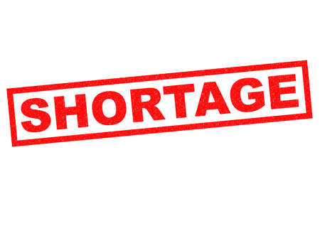 dearth: SHORTAGE red Rubber Stamp over a white background. Stock Photo