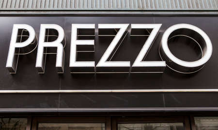 uk cuisine: LONDON, UK - APRIL 1ST 2015: A sign for a Prezzo Restaurant in London on 1st April 2015.  Prezzo are a group of Italian Restaurants and have over 150 of them accross Great Britain.