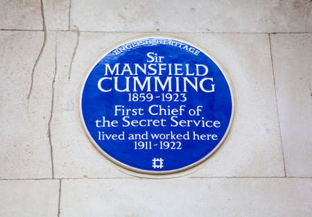 blue plaque: LONDON, UK - APRIL 1ST 2015: A blue plaque marking the former residence of Sir Mansfield Cumming, the first chief of the Secret Service on Whitehall Court in London on 1st April 2015.