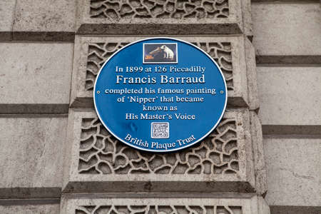 blue plaque: LONDON, UK - APRIL 1ST 2015: A blue plaque marking the location of where Francis Barraud completed his famous painting of 'Nipper' which became known as the symbol for HMV (His Master's Voice) on Piccadilly in London on 1st April 2015.