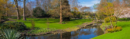 hyde: A panoramic view of a little waterfall and river in Hyde Park in London.
