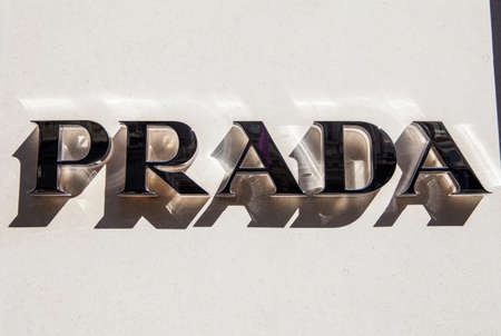 materialist: LONDON, UK - APRIL 7TH 2015: A sign for the Prada fashion store on Old Bond Street in centra London, on 7th April 2015.