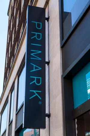 oxford street: LONDON, UK - APRIL 7TH 2015: A sign for a Primark clothing store on Oxford Street in central London on 7th April 2015.