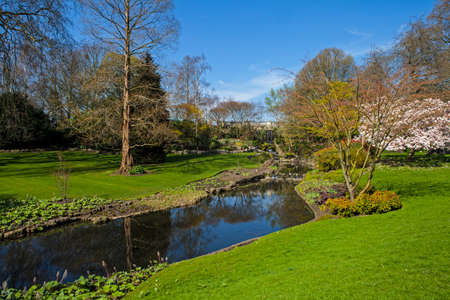 park: A panoramic view of a little waterfall and river in Hyde Park in London.
