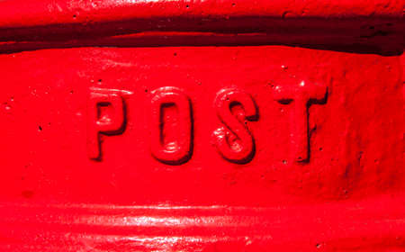 post box: A close-up of the word 'Post' on a red Post Box in the England. Stock Photo