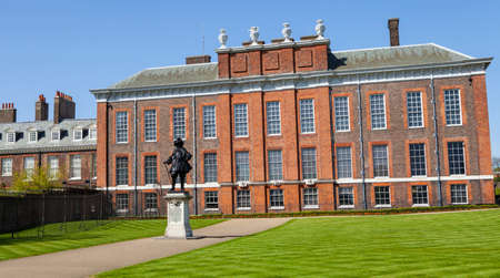 kensington: A view of the magnificent Kensington Palace in London with the statue of King William III in the foreground. Editorial