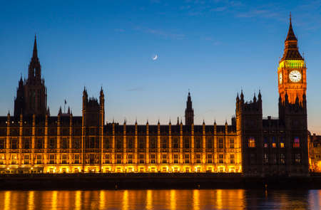 houses of parliament: A dusk-time view of the Houses of Parliament in London.