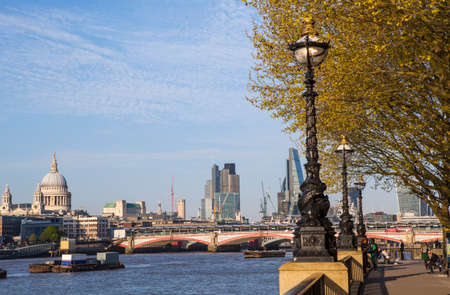blackfriars bridge: LONDON, UK - APRIL 20TH 2015: A view from the South Bank of the River Thames taking in the sights of St. Pauls Cathedral, Blackfriars Bridge, the River Thames and the skyscrapers in the City of London on 20th April 2015. Editorial